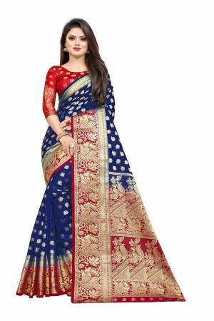For A Proper Traditional Look, Grab This Heavy Weaved Silk Based Designer Saree In Navy Blue Color Paired with Red Colored blouse. This Saree and Blouse Are Fabricated On Art Silk Which Gives A Rich Look To Your Personality.