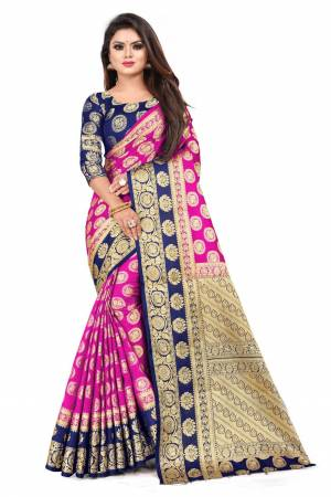 For A Proper Traditional Look, Grab This Heavy Weaved Silk Based Designer Saree In Rani Pink Color Paired with Navy Blue Colored blouse. This Saree and Blouse Are Fabricated On Art Silk Which Gives A Rich Look To Your Personality.
