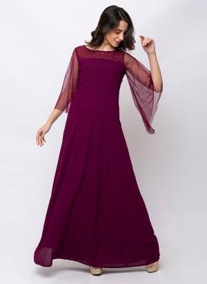 Here Is A Pretty Readymade Gown In Wine Color Fabricated On Georgette. This Gown Is Light In Weight And Suitable For Party Wear Or Wedding Function.