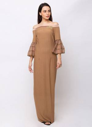 Flaunt Your Rich And Elegant Taste Wearing This Designer Readymade Gown In Beige Color. This Pretty Gown Has Elegant Off Shoulder Pattern. Its Rich Color And Fabric Will Definitely Earn You Lots Of Compliments From Onlookers.