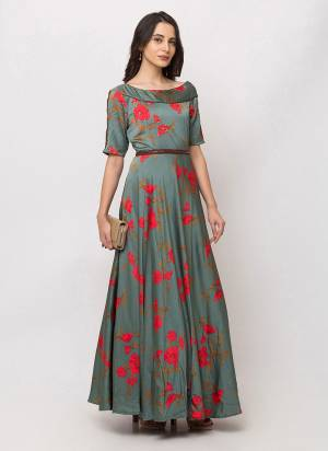 Celebrate This Festive Season Wearing This Designer Readymade Floor Length Gown In Steel Blue Color Fabricated On Satin. This Pretty Gown Is Beautified With Floral Prints Giving A Pretty Look.