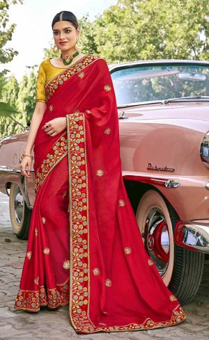 Adorn The Pretty Angelic Look Wearing This Heavy Designer Saree In Red Color Paired With Contrasting Yellow Colored Blouse. This Saree Is Fabricated On Satin Silk Paired With Art Silk Fabricated Blouse. Its Pretty Color Pallete Will Give An Attractive Look To Your Personality.
