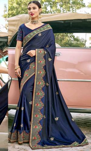 Celebrate This Festive Season In This Very Navy Blue Colored Saree Paired with Navy Blue Blouse. This Saree and Blouse Are Silk Based Beautified With Detailed Embroidery.