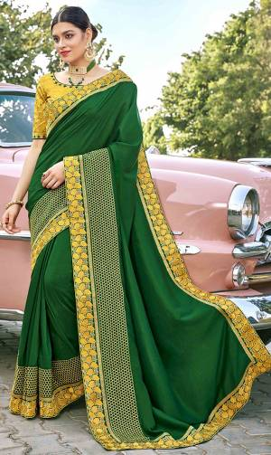 Grab This Pretty Elegant Looking Designer Saree In Green Color Paired With Contrasting Yellow Colored Blouse. This Saree And Blouse Are Silk Based Beautified With Embroidery. Buy Now.