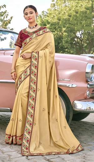 Adorn The Pretty Angelic Look Wearing This Heavy Designer Saree In Beige Color Paired With Contrasting Maroon Colored Blouse. This Saree Is Fabricated On Satin Silk Paired With Art Silk Fabricated Blouse. Its Pretty Color Pallete Will Give An Attractive Look To Your Personality.